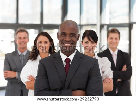 Young African American Business Man leading a team - stock photo