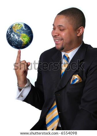 Young African American businessman balancing the earth on his finger.
