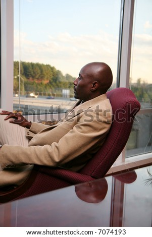 Young african american businessman dressed in a suit - stock photo