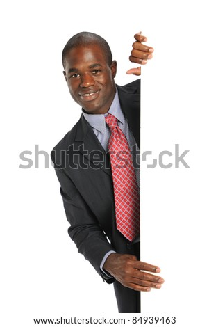 Young African American Businessman holding a blank sign isolated on a white background - stock photo