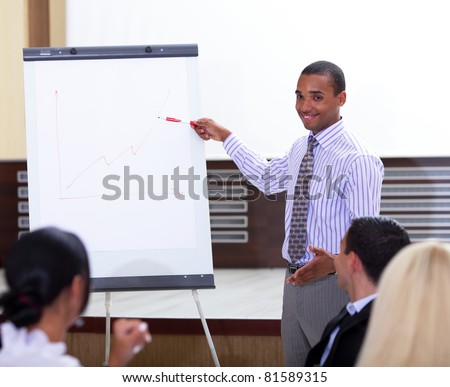 Young african-american businessman making a presentation - stock photo