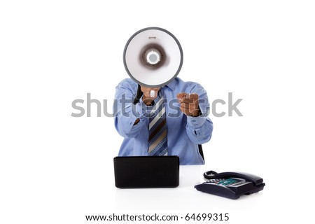 Young African American businessman with a megaphone in front face, pointing. Studio shot. White background. - stock photo