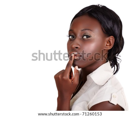 young African American businesswoman wearing light shirt looking with finger on her lips isolated on white with copy space - stock photo