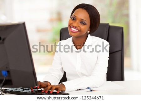 young african american businesswoman working on computer - stock photo