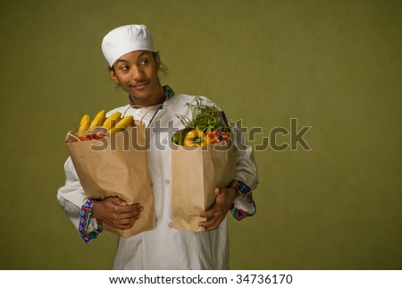 Young African American Chef Carrying Brown Paper Bags full of Groceries - stock photo
