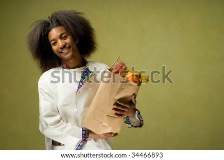 Young African American Chef with Brown Paper Grocery Bag - stock photo