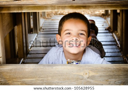 Young african-american child eating healthy snack while playing on playground - stock photo