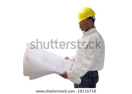 young African American contractor studying plans - stock photo