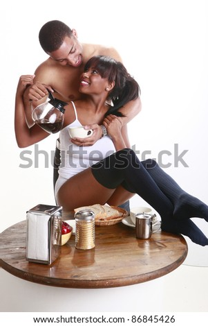 Young African American couple have fun and breakfast - stock photo