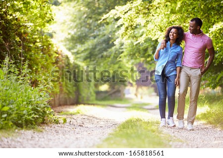 Young African American Couple Walking In Countryside - stock photo