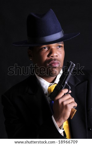 young African American dressed up as a gangster - stock photo