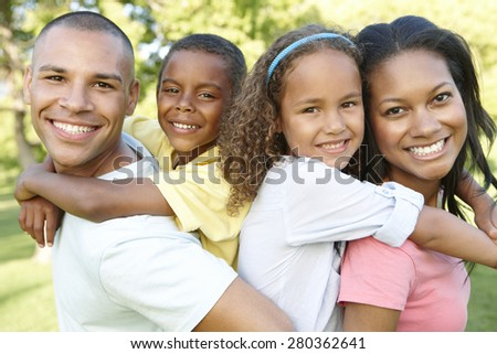 Young African American Family Relaxing In Park - stock photo