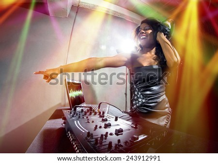 young african american female dj playing music at a party - stock photo