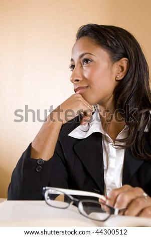 Young African-American female university student thinking and smiling - stock photo