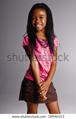 Young African American girl in a pink top and brown skirt