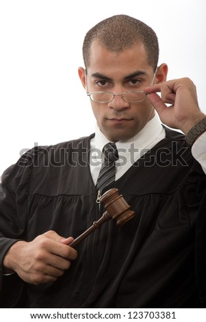 Young african american judge holding gavel - stock photo