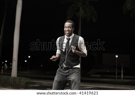 Young African American male dancing in the street
