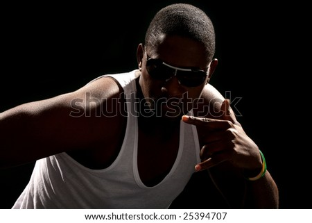 Young african american male on black background - stock photo