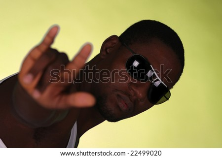 Young african american male on yellow background - stock photo