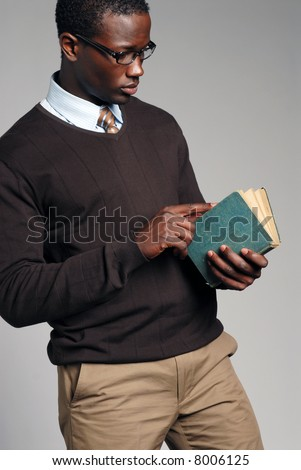 Young African American Male Reading Book - stock photo