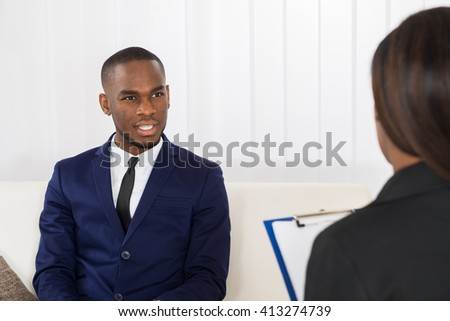 Young African American Man Explaining His Problems To The Psychologist - stock photo