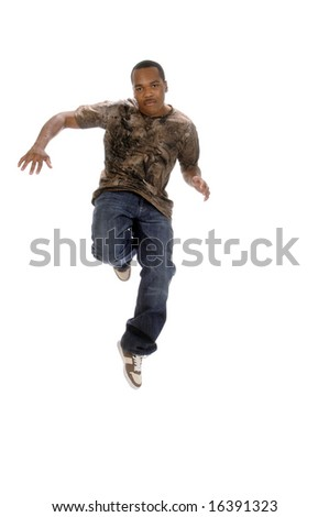 young African American man leaping in air - stock photo