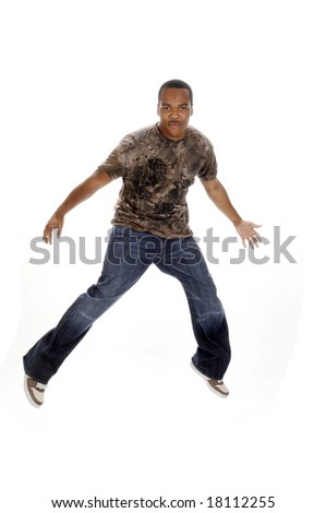young African American man leaping in the air - stock photo