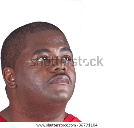 young African American man looking into copy space isolated on white