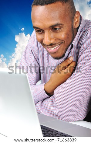 Young african american  man on laptop