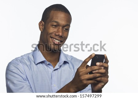 Young African American man texting with smartphone, horizontal - stock photo