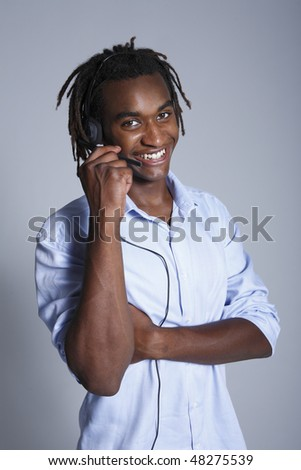 Young African American man wearing phone headset - stock photo