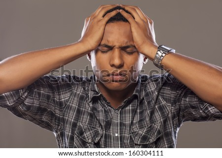 young african american man with headache - stock photo