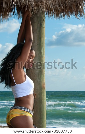 Young african american relaxes in the beach. - stock photo