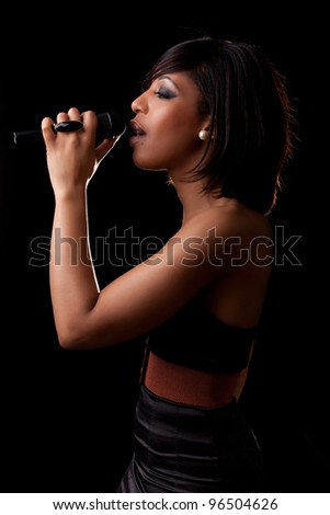 Young african american singer performing at concert - stock photo