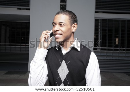 Young African American teenager on the phone - stock photo