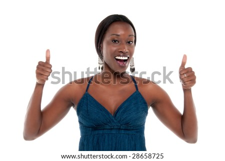 Young african american thumbs up giving approbation. - stock photo