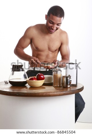 Young African American using your bread spread - stock photo