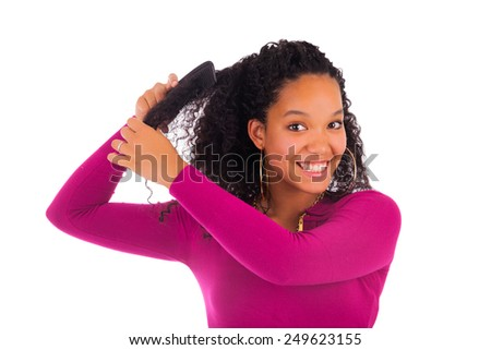 Young african american woman combing hair isolated - stock photo