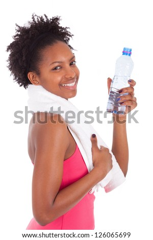 Young african american woman holding a bottle of water  over white background - stock photo