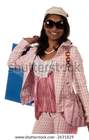 Young African American woman Holding colorful shopping bags - stock photo