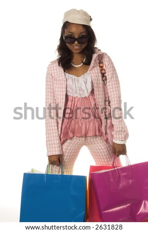 Young African American woman Holding colorful shopping bags  and looking over her sunglasses - stock photo