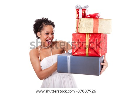 Young African American woman holding gifts boxes , isolated on white background - stock photo