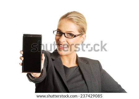 young african american woman presenting smart phone over white background - stock photo