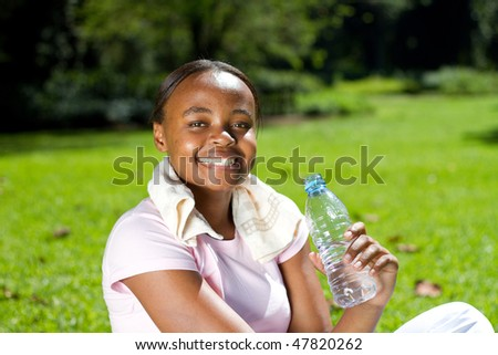 young african american woman relaxing after doing fitness workout - stock photo