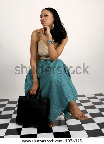 Young African American woman sitting with portfolio in her hand - stock photo