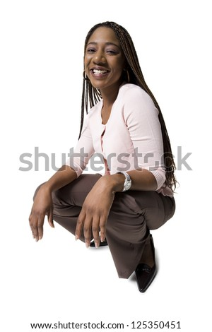 Young african american woman squatting