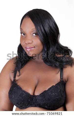 Young African American woman standing in black bra