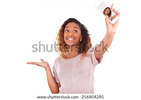 Young African American woman taking a selfie - stock photo