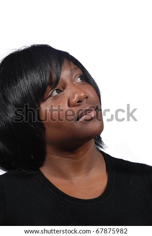 Young African American woman thinking, on white background - stock photo