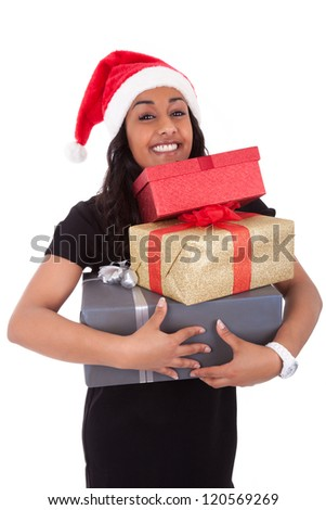 Young African American woman wearing a santa hat holding gift boxes, isolated on white background - stock photo